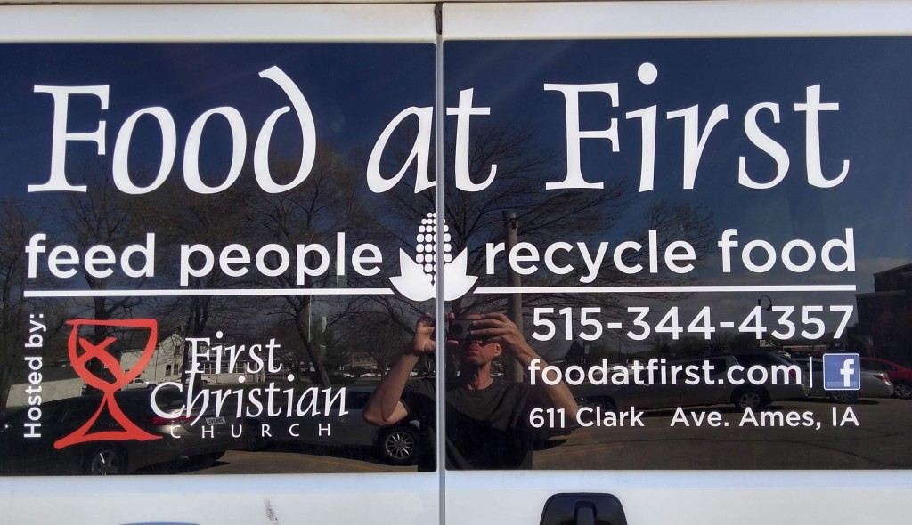 Food at First back window of van logo with Ed in the photo April 24 2019 warm day wearing short sleeves